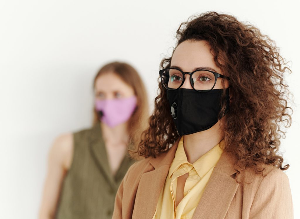 woman wearing glasses and protective mask on focus